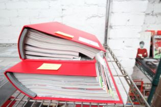 2x RED BINDERS OF MATCH DAY PROGRAMS, SEASON 2010 / 11