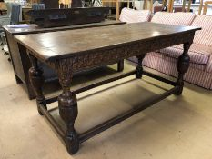 Medium sized three plank oak refectory table with pegged breadboard ends and carved legs and