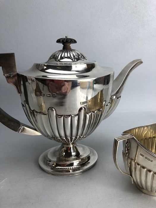 Silver hallmarked three piece tea set to include a large teapot (approx 702g) milk jug (approx 103g) - Image 4 of 5