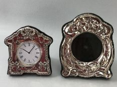 Hallmarked silver framed clock and a hallmarked silver photo frame