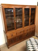 Imported Chinese rosewood sideboard with glass cupboards and shelving over, Chinese carved detailing