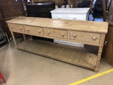 Very large pine farmhouse kitchen sideboard with four large drawers and shelf under, on turned front
