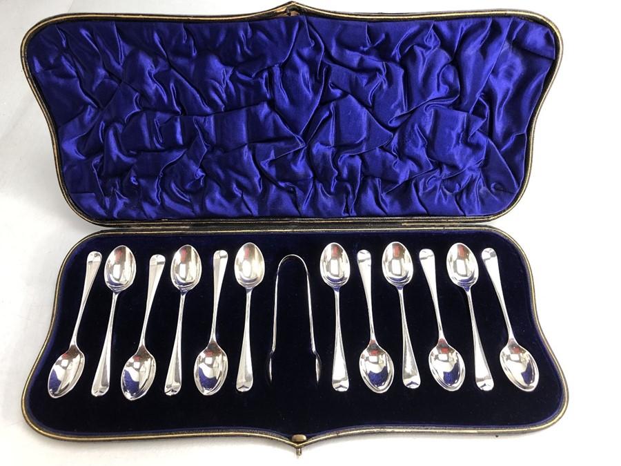 Set of Hallmarked 1905 Silver twelve teaspoons and sugar tongs in in blue velvet and silk
