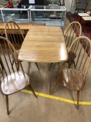Blonde Ercol Dining table and four stick back chairs