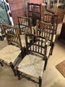 Set of six spindle back, rush seated dining chairs to include one carver