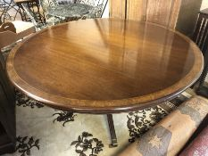 Large Victorian pedestal dining table on brass castors with walnut detailing, approx 165cm in