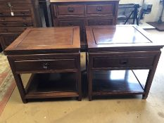 Pair of Imported Chinese rosewood side tables with carved detailing, drawer and shelf under,