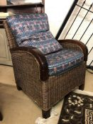 Small wicker arm chair with two cushions