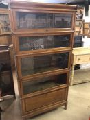 Five section Globe Wernicke English-made bookcase with metal bindings, stands approx 183cm tall,