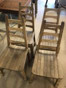 Set of four wooden slatted ladder back chairs