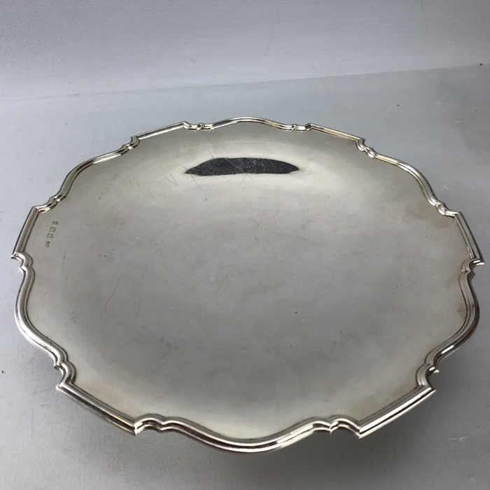 Silver hallmarked large dish on single foot approx 552g/ 26cm diameter