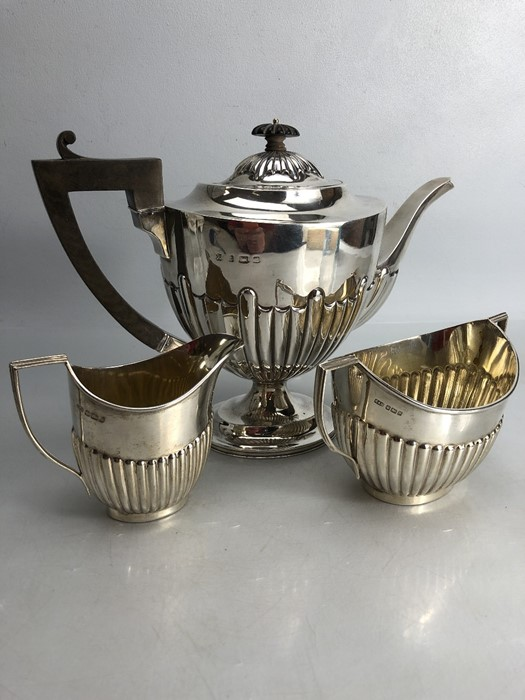 Silver hallmarked three piece tea set to include a large teapot (approx 702g) milk jug (approx 103g)