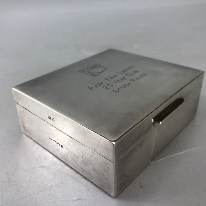 """Silver hallmarked cigarette box engraved to lid """"Rank Film Library"""" 9 x 8 3.5cm by Garrard & Co"""