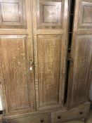 Oak triple wardrobe with two drawers under by R.H. Whittle & Sons