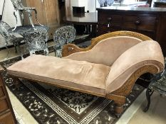 Chaise Lounge with carved oak frame and turned legs on castors