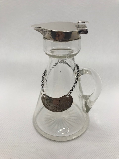 Glass whisky noggin with hallmarked silver pourer and silver hallmarked whisky label