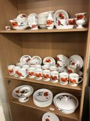 A collection of Wedgwood Susie Cooper design Cornpoppy pattern wares