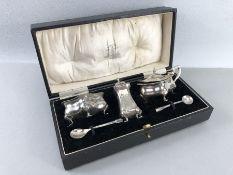 Silver hallmarked Cruet set in original presentation box including salts, pepper and spoons