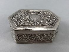 Unmarked Silver repousse decorated pill box with blank cartouche