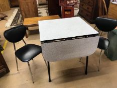 Small melamine-topped drop leaf retro kitchen table with with two black padded, chrome-legged