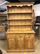 Pine dresser with three cupboards and drawers under and three shelves over, approx 208cm tall x