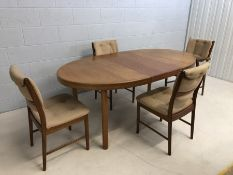 Mid Century oval extending dining table with four chairs (one carver). Approx dimensions fully