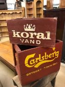 Two vintage painted wooden crates, one marked Koral Vand, the other Carlsberg