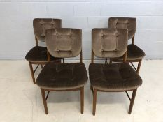 Set of four Mid Century teak chairs with padded seats and backs