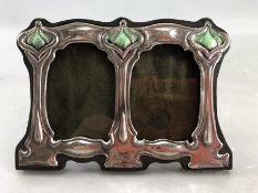 Small silver Art Nouveau style double picture frame, approx 11cm x 8cm