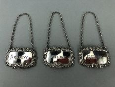 Three hallmarked Silver matching bottle labels, Whisky, Brandy & Sherry on chains