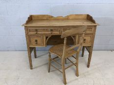 Small antique pine desk with four drawers and upstand, matching brass handles, accompanied by pine