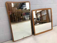 Two Mid Century wooden framed mirrors, one by Clark Eaton, the largest approx 68cm x 39cm