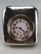 Goliath pocket watch in working order, contained in a silver watch stand hallmarked Birmingham 1914.