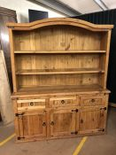 Large pine kitchen dresser with three drawers and cupboards under, approx 154cm x 51cm x 190cm tall