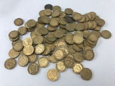 Collection of more than 100 brass threepenny pieces with various dates