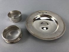 Two hallmarked SIlver napkin rings and a hallmarked silver dish (approx 150g)