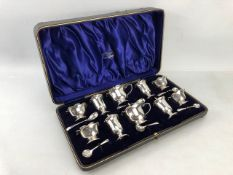 Sixteen piece boxed set of hallmarked silver cruet set with blue glass liners (salts and