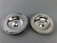 Two similar hallmarked silver dishes London hallmarks the largest approx. 12cm diameter and total