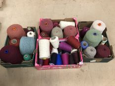 Large collection of wool and yarn in a variety of colours across four boxes. Approx 35 reels/cones