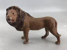 Small cold painted bronze of a lion, approx 10cm in length
