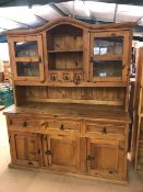 Large pine kitchen dresser with three cupboards and three drawers under and two glazed doors