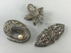 Three vintage Marcasite brooches to include Maple Leaf London 1960, Oval form set with Cultured