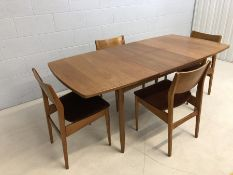 Mid Century teak extending dining table by White & Newton of Portsmouth, with four chairs with