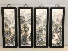 Set of four Chinese framed porcelain plaques depicting mountainous scenes, each approx 80cm x 28cm