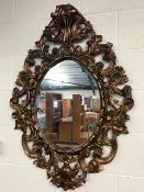 Large oval Rococo style mirror with ornate frame, approx 100cm tall x 74cm wide