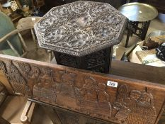 Two carved wooden items to include a folding side table with leaf decoration and a carved wooden