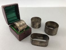 Four hallmarked silver napkin rings one in presentation box