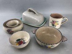 Five pieces of Poole pottery to include two bowls, small mug ,posie ring and butter dish