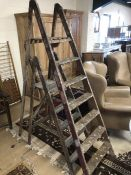 Two vintage decorators ladders, the tallest approx 6ft