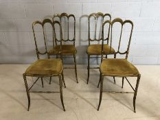 """Set of heavy four Brass framed chairs stamped """"Made In Italy"""". Four Italian brass salon chairs."""